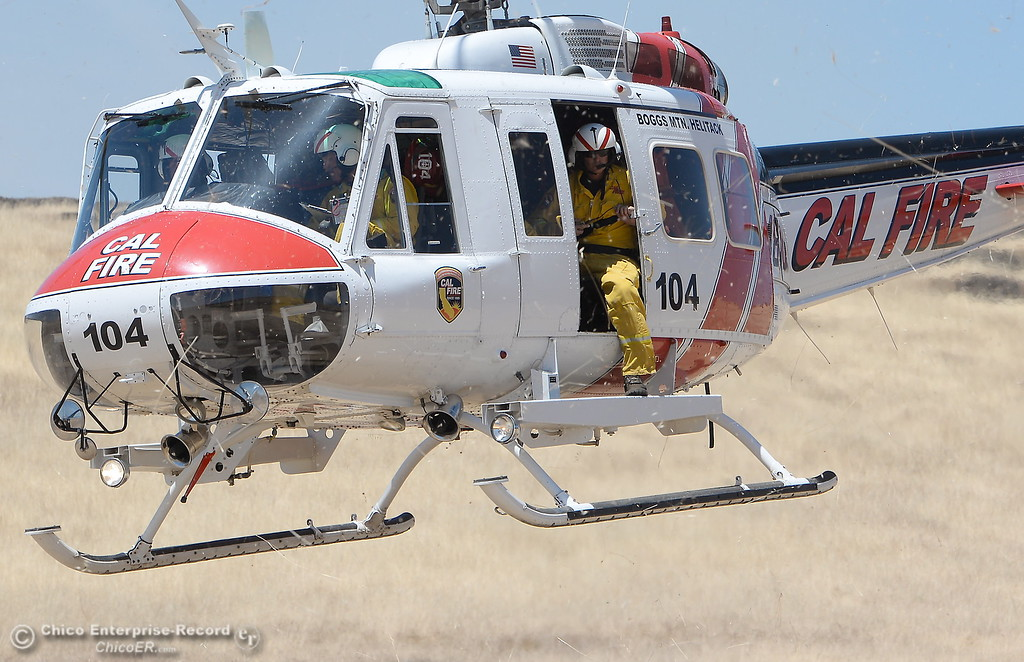 . A CAL FIRE Helitack helicopter from Boggs Mt. takes off after assisting firefighters with a grass fire that burned approx. 91 acres along Nelson Road in Oroville, Calif. Tues. June 6, 2017. (Bill Husa -- Enterprise-Record)