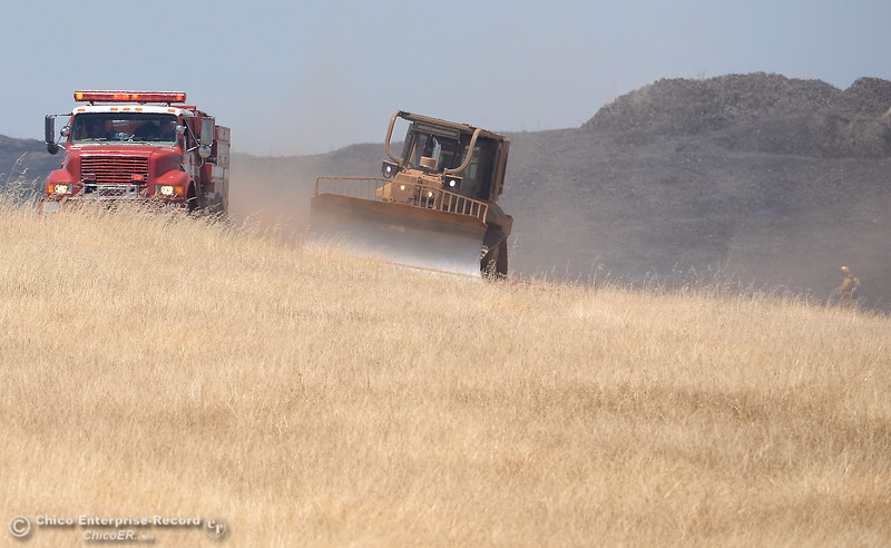 Engines and dozers work together on a grass fire of approximately 91 acres seen along Nelson Road in Oroville, Calif. Tues. June 6, 2017. (Bill Husa -- Enterprise-Record)