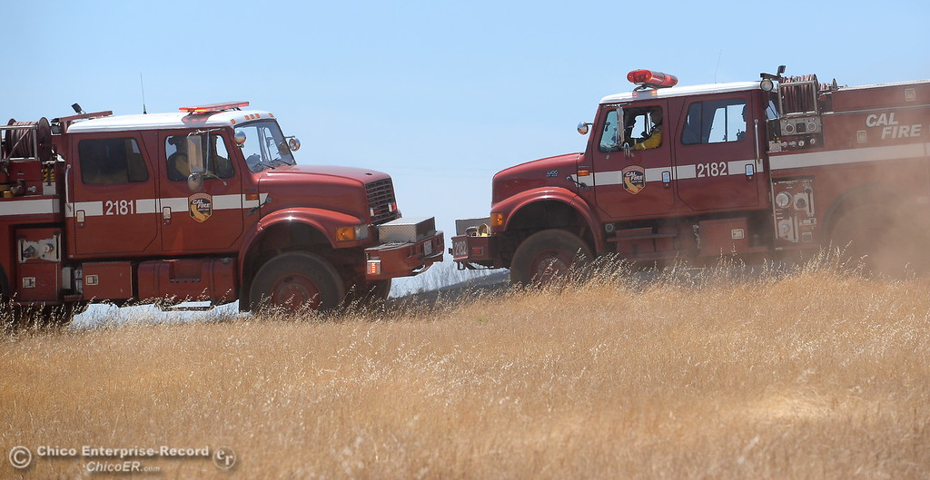 . Engines and dozers work together on a grass fire of approximately 91 acres seen along Nelson Road in Oroville, Calif. Tues. June 6, 2017. (Bill Husa -- Enterprise-Record)