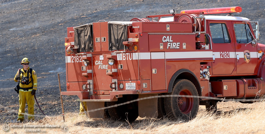 . CAL FIRE Firefighters with engine 2182 work on the perimeter of a grass fire seen along Nelson Road in Oroville, Calif. Tues. June 6, 2017. (Bill Husa -- Enterprise-Record)