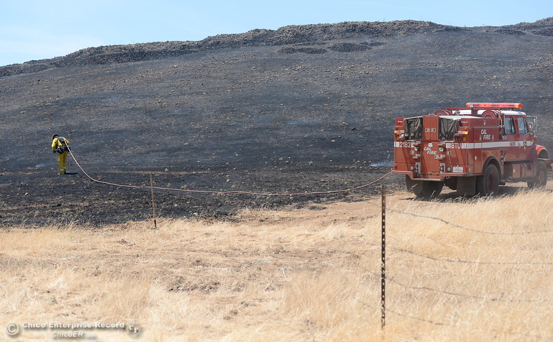 CAL FIRE Firefighters with engine 2182 work on the perimeter of a grass fire seen along Nelson Road in Oroville, Calif. Tues. June 6, 2017. (Bill Husa -- Enterprise-Record)