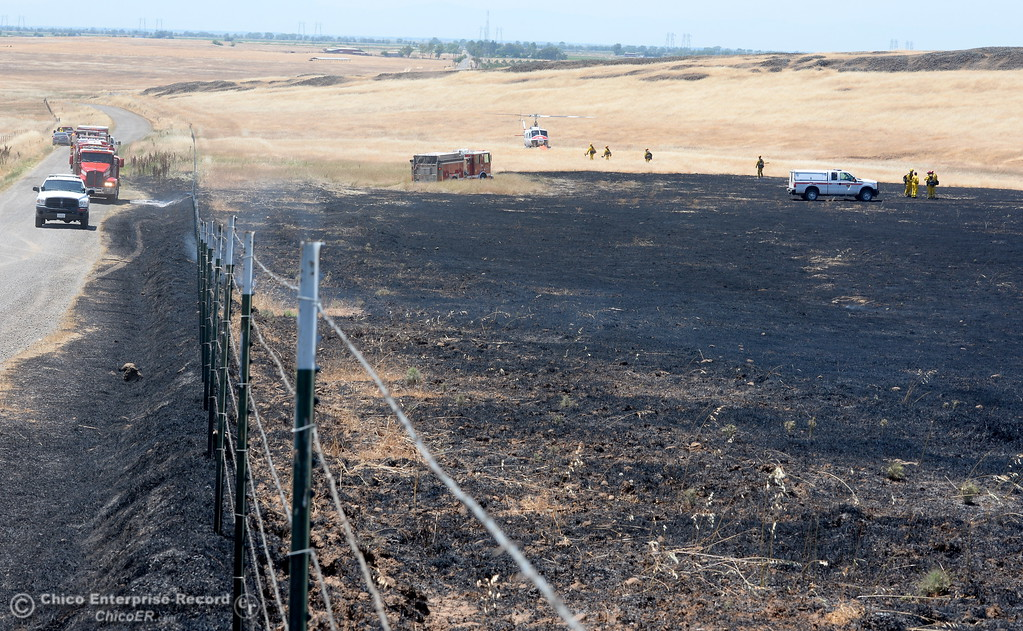 . Nelson Road stops the fire at left while firefighters work on a fire that burned approx. 91 acres along Nelson Road in Oroville, Calif. Tues. June 6, 2017. (Bill Husa -- Enterprise-Record)