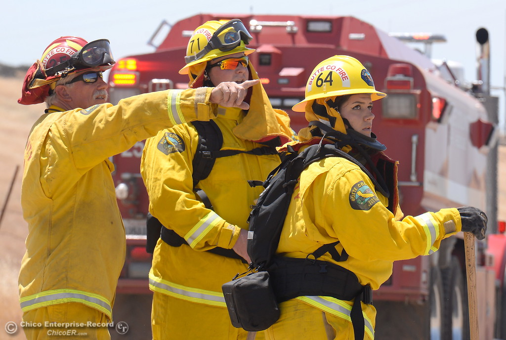 . Firefighters communicate near a water truck as they work on a 90 acre fire seen along Nelson Road in Oroville, Calif. Tues. June 6, 2017. (Bill Husa -- Enterprise-Record)