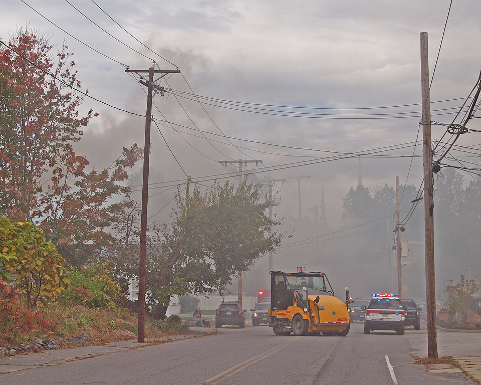 . Smoke fills the air in the area of Leominster where a home at 8 Eden Glen St. burned during a man\'s standoff with police Monday, Oct. 16, 2017. SENTINEL & ENTERPRISE / ROBERT ALLEN