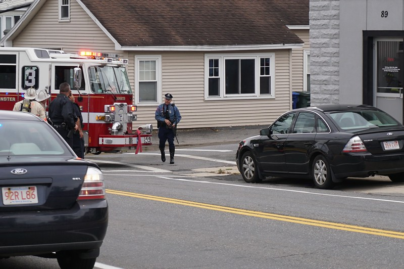 State trooper with rifle dranw outside standoff at 8 Eden Glen St. in Leominster.<br /> SENTINEL & ENTERPRISE / CLIFF CLARK
