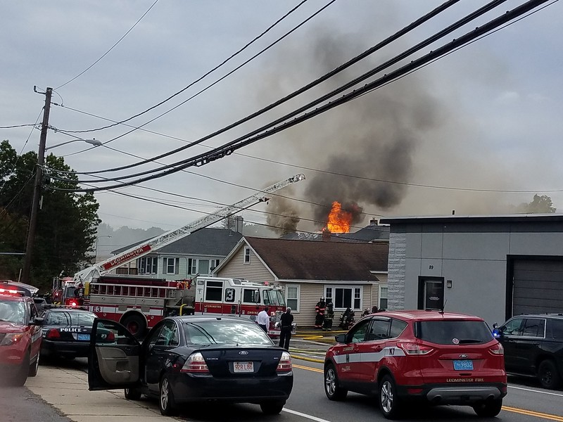 Flames shoot from 8 Eden Glen St. in Leominster during standoff Monday.<br /> SENTINEL & ENTERPRISE / CLIFF CLARK