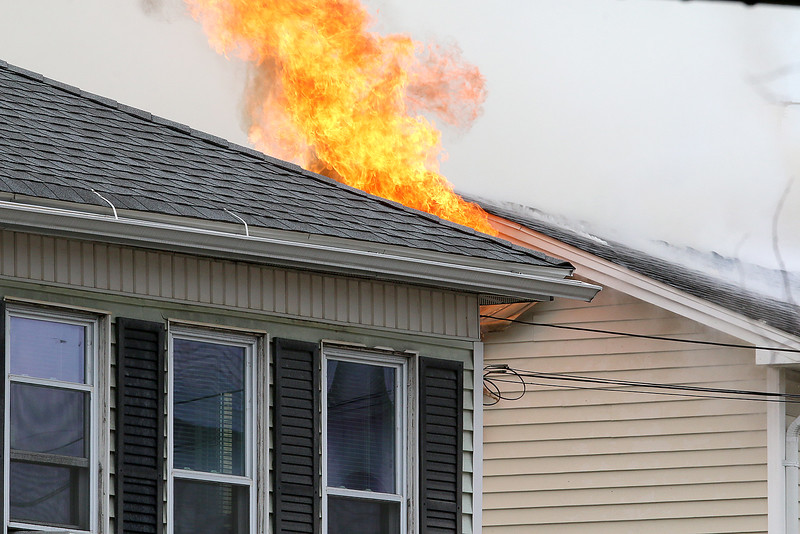 Fire is seen coming from the roof during a standoff and blaze at 8 Eden Glen Street in Leominster on Monday, Oct. 16, 2017. SENTINEL & ENTERPRISE / JOHN LOVE