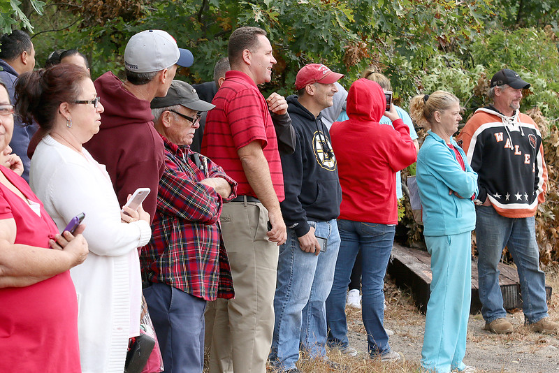 Residents watch as fire shoots from the roof of a home at 8 Eden Glen Street during a standoff and blaze in Leominster on Monday, Oct. 16, 2017. SENTINEL & ENTERPRISE / JOHN LOVE