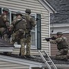 Members of the State Police Special Tactical Operations Team prepare to enter 8 Eden Glen St. in Leominster on Monday after a man barricaded himself in the home and set it ablaze. The man was later found dead inside the home.<br /> SENTINEL & ENTERPRISE / DAVID BRYCE