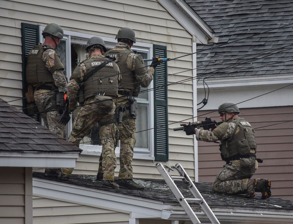 . Members of the State Police Special Tactical Operations Team prepare to enter 8 Eden Glen St. in Leominster on Monday after a man barricaded himself in the home and set it ablaze. The man was later found dead inside the home. SENTINEL & ENTERPRISE / DAVID BRYCE