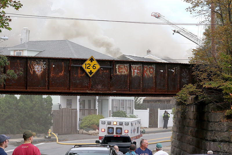 Smoke can be seen coming from the roof at the site of a standoff and blaze at 8 Eden Glen Street in Leominster on Monday, Oct. 16, 2017. SENTINEL & ENTERPRISE / JOHN LOVE
