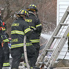 Firefighters from Westminster, Hubbardston, Gardner, and Fitchburg were on scene of a house fire at 129 Knower Road in Westminster. Firefighter spray down some things in the backyard of the home just after the fire was put out. SENTINEL & ENTERPRISE/JOHN LOVE
