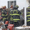 Firefighters from Westminster, Hubbardston, Gardner, and Fitchburg were on scene of a house fire at 129 Knower Road in Westminster. Fire fighter at the fire huddle together as the weather changed and snow started to fall. SENTINEL & ENTERPRISE/JOHN LOVE