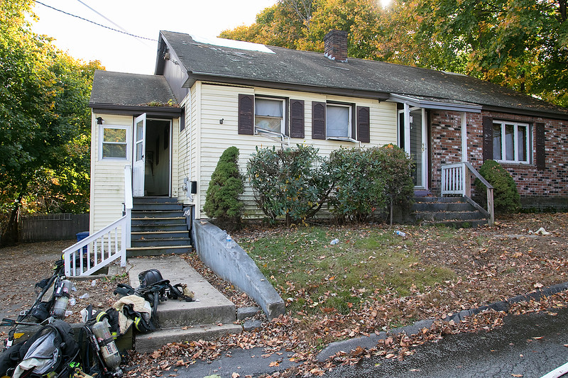 Leominster Fire responded to a fire in the basement of this home at 13 Graham Street Saturday, Oct. 26, 2019. Their was a fire in the basement of the house that was unoccupied because the owner is in the process of selling the home. SENTINEL & ENTERPRISE/JOHN LOVE