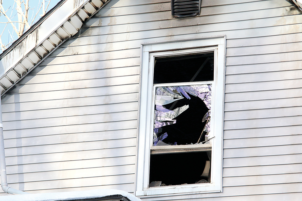 . A fire broke out at 81 Narrows Lane, the home of six apartments, around midnight on January 9, 2018. A broken window at the home on the third floor. SENTINEL & ENTERPRISE/JOHN LOVE