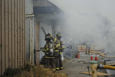 Humboldt Bay Fire personnel used a chainsaw and a circular saw (not pictured)  to access and ventilate the burnt out Blue Heron Residences on Broadway  in Eureka on Monday afternoon. (Hunter Cresswell - The Times-Standard)