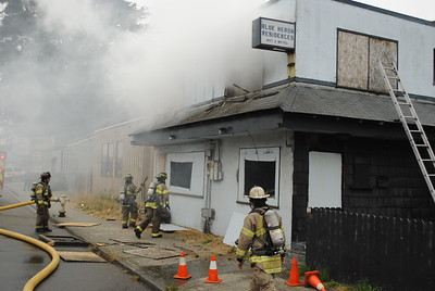 Humboldt Bay Fire fought a blaze that destroyed the boarded-up Blue Heron Residences on Broadway on Monday afternoon. (Hunter Cresswell - The Times-Standard)