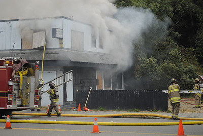 Humboldt Bay Fire fought a blaze that destroyed the boarded up Blue Heron Residences on Broadway on Monday afternoon. (Hunter Cresswell - The Times-Standard)