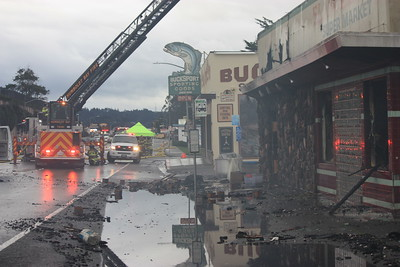 Puddles filled with charred debris sits in front of the El Pueblo Market in Eureka, which was destroyed by a fire on Wednesday. (Will Houston - The Times-Standard)
