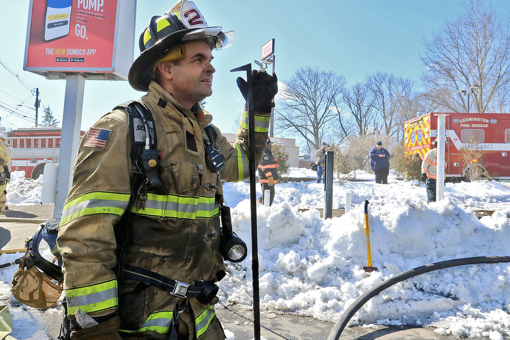 . A fire broke out at the Sunoco station on Route 13 in Leominster early on Thursday morning. Sterling Fire Lt. Tom Kokernak takes a break from fighting the fire. SENTINEL & ENTERPRISE/JOHN LOVE
