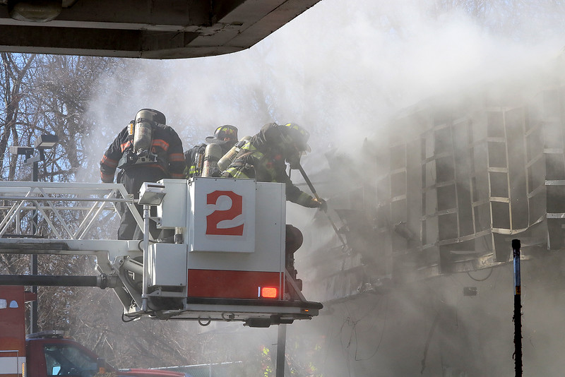 A fire broke out at the Sunoco station on Route 13 in Leominster early on Thursday morning. Firefighters work from the bucket on the ladder truck as they fight the fire. SENTINEL & ENTERPRISE/JOHN LOVE