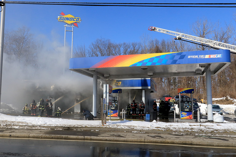 A fire broke out at the Sunoco station on Route 13 in Leominster early on Thursday morning. A view from the street as about 50 to 60 firefighter from the city and surrounding towns and cities help fight the fire. SENTINEL & ENTERPRISE/JOHN LOVE