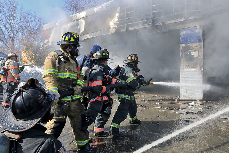 A fire broke out at the Sunoco station on Route 13 in Leominster early on Thursday morning. Firefighters spray down the bays at the station as they fight the fire. SENTINEL & ENTERPRISE/JOHN LOVE