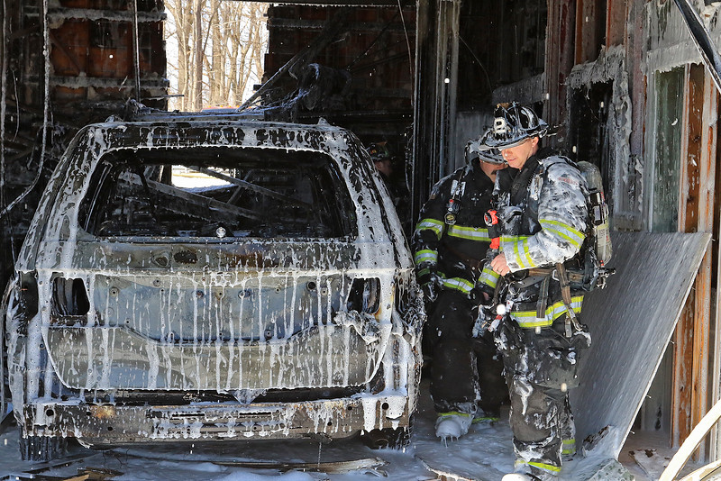 A fire broke out at the Sunoco station on Route 13 in Leominster early on Thursday morning. Firefighters sprayed some foam on a now destroy car that was in one of the bays as the fire broke out. SENTINEL & ENTERPRISE/JOHN LOVE