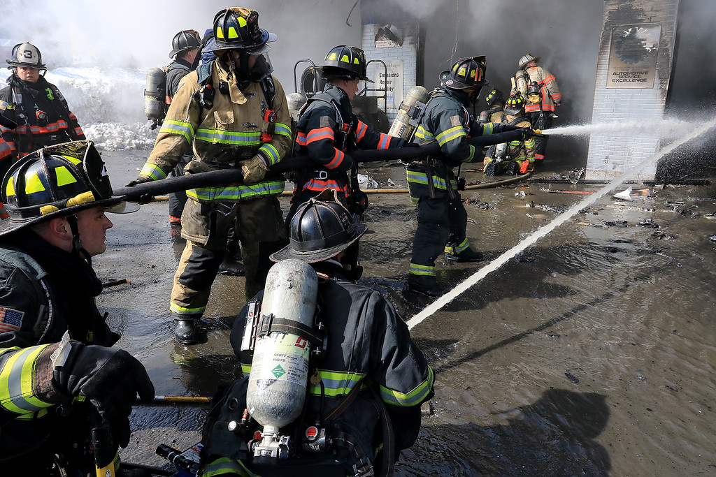 . A fire broke out at the Sunoco station on Route 13 in Leominster early on Thursday morning. Firefighters spray down the bays at the station as they fight the fire. SENTINEL & ENTERPRISE/JOHN LOVE