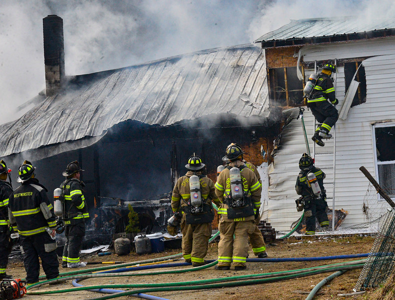 KRISTOPHER RADDER — BRATTLEBORO REFORMER<br /> Multiple agencies responded to a two-alarm fire at 25 Coburn Hill Road, in Rockingham, Vt., on Tuesday, March 31, 2020.