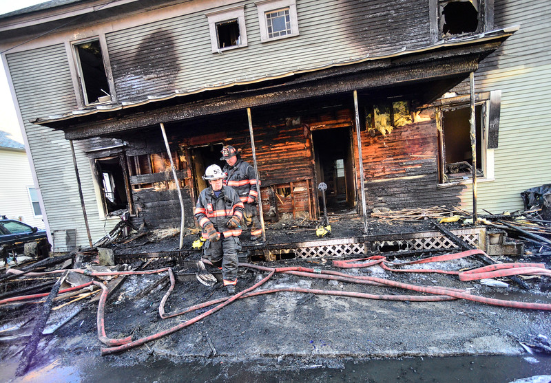 KRISTOPHER RADDER — BRATTLEBORO REFORMER<br /> Investigators try to find a cause of a two-alarm fire at 3 and 5 Laurel Avenue, in Bellows Falls, Vt., on Wednesday, Jan. 29, 2020. The fire started around 5:15 a.m. and serious injuries were reported but one woman was sent to Springfield Hospital to be evaluated.
