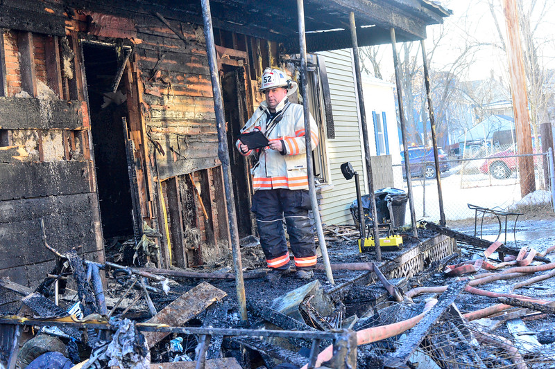 KRISTOPHER RADDER — BRATTLEBORO REFORMER<br /> Bellows Falls Fire Chief Shaun McGinnis documents the fire damage to 3 and 5 Laurel Avenue as they look for a cause of the fire on Wednesday, Jan. 29, 2020.