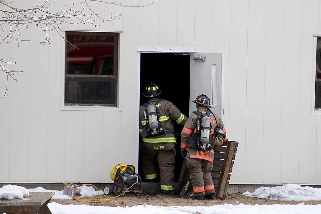 . Fire Departments from towns all around Ayer were on scene at Advanced Vacuum Systems\' a Speciality Furnace Equipment business in Ayer on Friday night to help out at a incident that had one person lifefighted.  Firefighter enter the building on Fitchburg Road.  SENTINEL & ENTERPRISE/JOHN LOVE