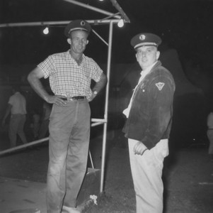 Archie Tolbert and Joe Feith beside car stand last night of carnival