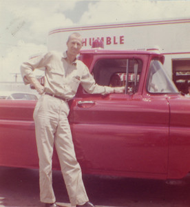 Sam Carter standing by truck (Chief) Bill Berry at wheel
