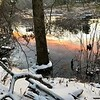 The setting sun colors the Shawsheen River pink and orange. Photo by Mary Leach