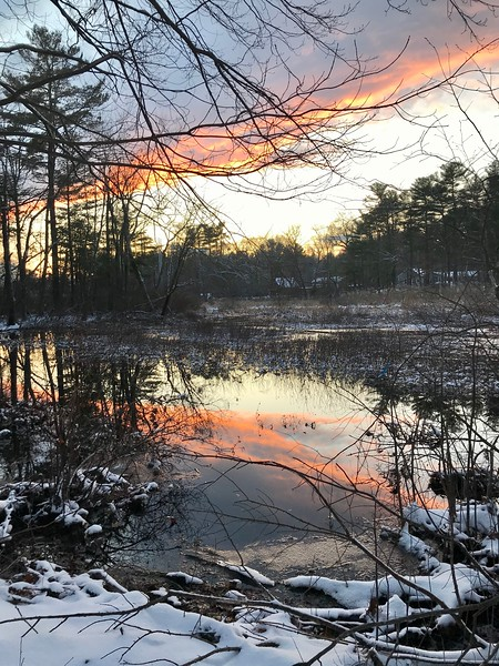 The sunset was seen in the still water of the Shawsheen River in Billerica. Photo by Mary Leach