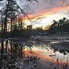 The setting sun is reflected in the calm waters of the Shawsheen River in Billlerica on Dec.18. Photo by Mary Leach