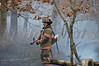 On 03/26/2014 at approx. 09:20 hrs. the Manorville F.D. was toned out for a reported brush fire on Grumman Blvd. to the east of Line Rd. First arriving units found a large area of brush burning on the south side of Grumman Blvd. and requests were made for mutual aide from Wading River, Ridge, and Riverhead. The Riverhead P.D. and Suffolk County Sheriffs were on scene as well. Arson was requested to the scene.