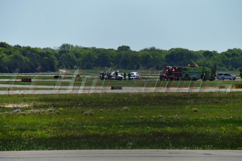 """Damaged plane on runway at MacArthur Airport Monday, May 20, 2014. The pilot of a small plane radioed in to the tower that their landing gear would not go down and that they needed to make an emergency """"gear-up"""" landing at MacArthur Airport at approx. 10:30 a.m. No injuries were reported."""