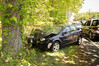 Route 58 in Riverhead Thursday May 29, 2014. The RVAC and Riverhead P.D. responded  at approx. 12:50 p.m.when the man driving this 2008 Chevy Cobalt, according to authorities, swerved to avoid hitiing the car in front of him and struck the tree. The Cobalt was traveling west bound on 58 opposite King Kullen when the wreck occurred. The driver, and sole occupant, of the vehicle was transported bt RVAC to PMBC with undisclosed injuries.