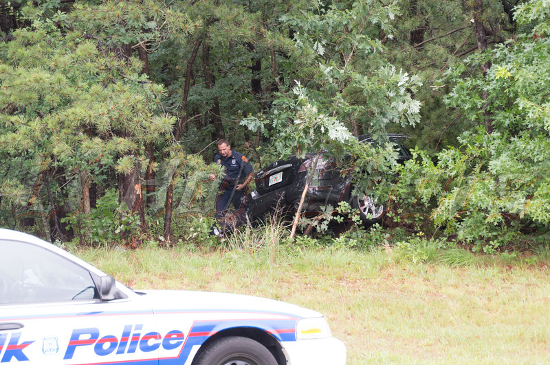 Suspects wreck car in East Patchogue on Friday, July 4, 2014. The driver of this Nissan Maxima, who had earlier outran SCPD 5th Pct. officers, apparently lost control of his car, while attempting to exit the westbound Sunrise Hwy. at Hospital Road at approx. 5:45 p.m., crashing into the woods. Two suspects were taken into custody a short time later, with the assistance of the SCPD K-9 unit, after fleeing the accident scene.