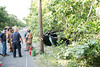 Car hits pole and flips into woods in Manorville Wednesday, July 30, 2014. Two people were injured when the operator of this four-door sedan lost control, struck a telephone pole and flipped into the woods, while traveling north on Wading River Road near Cedar Lane at approx. 4:35 p.m. The driver and passenger were transported by ambulance to Brookhaven Memorial Hosp. in Patchogue.