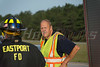 """Overturned truck on Sunrise Hwy. in Eastport Tuesday, August 12, 2014. The driver of a Ford F-350 was injured when his truck overturned at approx. 7:00 a.m. while traveling east bound on Sunrise Hwy. (Rt. 27) about a 1/2 mile west of exit 63 (Old Riverhead Road). Under the direction of Chief William Weick (05-08-30) firefighters from the Eastport F.D. and officers from the SCPD ESU worked together using the """"Jaws of Life"""" to extricate the driver from his vehicle. The driver was transported to the hospital by ambulance with undisclosed injuries. One lane was closed and east bound traffic on Sunrise Hwy. was backed up for almost three miles."""