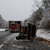 "The Wading River F.D. & SCPD responded to this overturned auto which occurred at approx. 10:30a.m. on Tues. 12/10/2013. The woman driving this SUV was seriously injured when her car flipped over numerous times while she was traveling south on the William Floyd Pkwy, approx. 1/2 mile south of Rt. 25a in Wading River. Wading River fire chief McQueeney said ""Thank God she was wearing her seatbelt or her injuries would have been a whole lot worse. It definitely saved her life."""