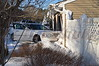 On 01/22/2014 at approx. 2:40 p.m. the Ridge FD & SCPD 7th Pct. responded to this car into a house at 177 Randall Rd. on the corner of Bradley Dr. An elderly gentleman apparently lost control while heading north bound on Randall, bounced off a large plow (tearing apart the rear passenger door), and then careened into the occupied house. It was reported there was a baby sleeping in a room, next to the room that was struck, and was unharmed. There was damage to the house. The driver of the Lincoln Town Car was injured and transported to the hospital by Ridge FD ambulance.