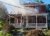 First arriving crews enter a house on Cottage St with a report of a person trapped. SENTINEL&ENTERRPRISE/ Jim Marabello