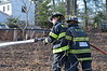 "11/24/2013 13:25 hrs. Middle Island Fire Dept.-Brush Fire-104 Middle Island Blvd (1) : The Middle Island F. D. was alerted for a reported brush fire to the rear of 104 Middle Island Blvd. on Sunday, 11/24/2013 at approx. 13:25 hrs. MIFD's first arriving chief advised incoming units that they had a large area of brush and it was close the houses. 1 3/4"" lines were stretched to protect the houses from auto exposure and brush trucks were put to work with additional hand lines. MIFD's Bravest, along with mutual aid from Gordon Heights, were able to knock down the fire before any damage was done to the near-by dwellings."
