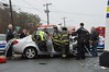 """04/08/2014 0910 hrs N Patch Waverly Ave & BuckleyRd MVA-Lambui : Bus and car collide in North Patchogue Tuesday, April 8, 2014.  The North Patchogue F.D. and officers from the SCPD 5th Pct. and Emergency Services Unit (ESU) responded at approx. 9:10 a.m. to an accident between a Suffolk County Transit bus and a Chevy four-door sedan at the intersection of Waverly Ave. and Buckley Rd. The driver of the Chevy was trapped in his vehicle and seriously injured requiring transport by ambulance to Stony Brook Hospital. Two other people reported minor injuries and were transported to Brookhaven Memorial Hosp. SCPD Crime Scene Units were called to the scene due to the severity of injuries to the driver in the Chevy. North Patchogue firefighters, under the command of Chief Doscher, and SCPD ESU officers had to use hydraulic """"Jaws of Life"""" to cut the driver out of the Chevy's wreckage."""