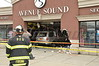 04/08/2014 1420 hrs Patchogue Main & 112 MVA-Lambui : Stolen car crashes into business in Patchogue Tuesday, April 8, 2014.  A Honda Pilot SUV which was allegedly stolen from a local Jiffy Lube crashed into Audio Sound on Main Street at the intersection of Route 112. The driver crashed at approx. 2:20 p.m. after being briefly pursued by Suffolk County Police 5th Pct. officers, he was southbound on Rt. 112 at the time. After a brief foot chase, the suspect was apprehended by SCPD officers. There were a few minor injuries to bystanders reported. The Patchogue F.D.'s Chief Baer (05-19-30) was in charge of the scene. North Patchogue F.D. responded on mutual aid under command of Chief Doscher (05-17-30).